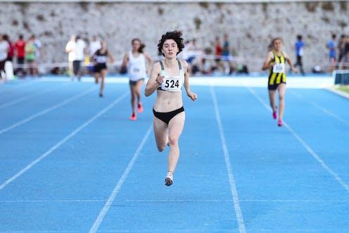 Women race on a blue track