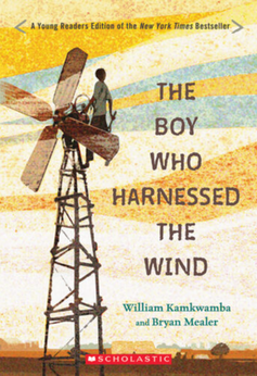 Children's book cover of boy standing on a windmill