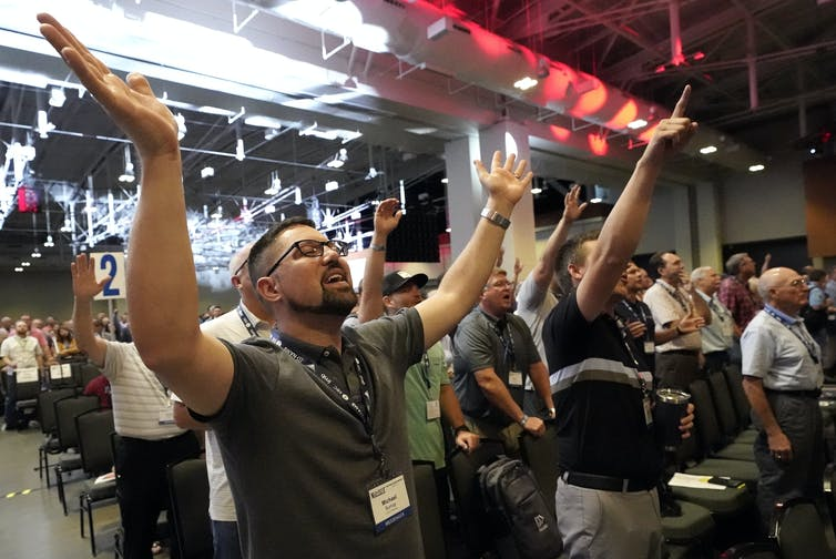 People take part in a worship service during the annual Southern Baptist Convention meeting in June 2021, in Nashville, Tennessee.