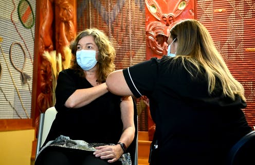 New Zealand's chief science advisor Dame Juliet Gerrard receiving her first vaccination dose.