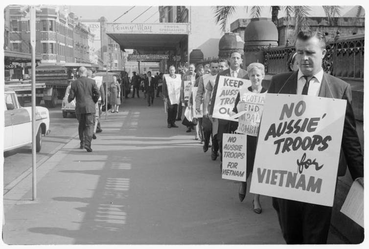 Man wears a placard reading 'No Aussie troops for Vietnam'