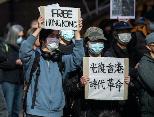 """Protester holding up """"Free Hong Kong"""" sign"""