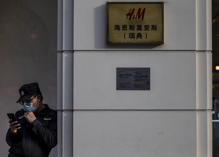 A security guard outside of an H&M store in Shanghai.