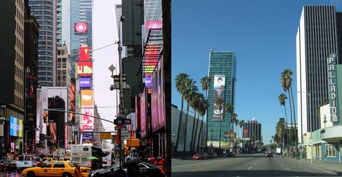 On the left, skyscrapers extending out of the frame surround a street full of traffic, billboards and neon signs line the street; on the right, a theater and several tall office buildings interspersed with tall palm trees line a wide boulevard