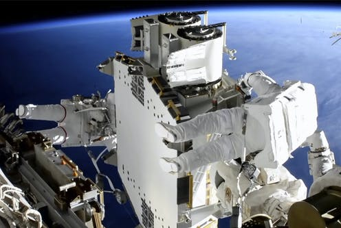Astronauts Shane Kimbrough and Thomas Pasquet work on the International Space Station