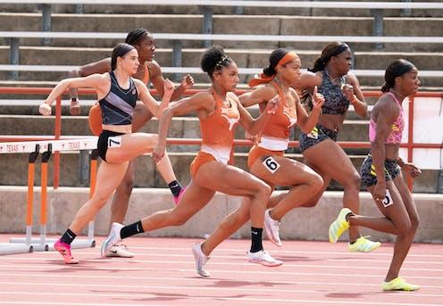 Several women run in a hurdles race