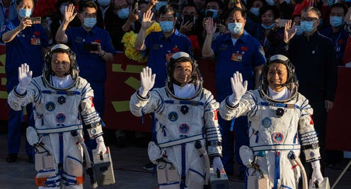 Chinese astronauts Tang Hongbo, Nie Haisheng, and Liu Boming during ceremony before heading to Tiangong.