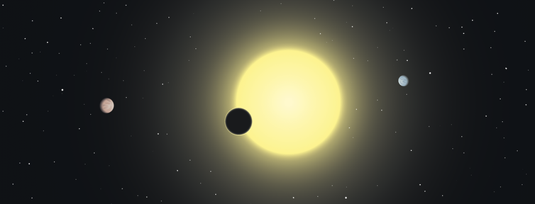 A drawing of a planet passing in front of its star.