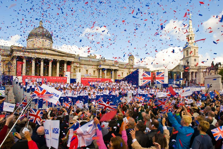 Crowds celebrate the 2008 GB team's medal haul on the Olympic Parade in London