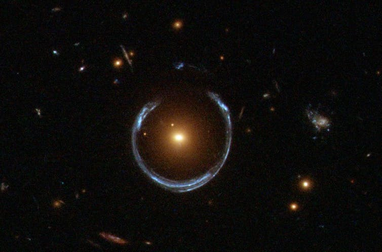 An image of a bright galaxy with a blue ring around it.