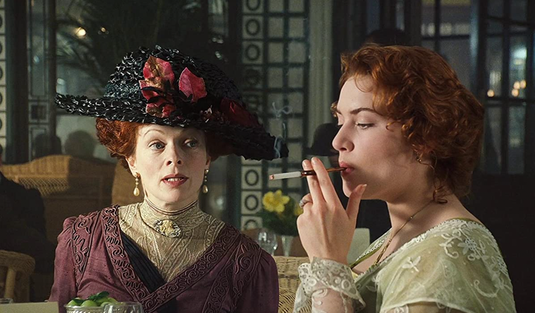 Two women in period costume, one smoking