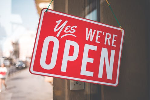 Shop sign saying 'Yes, we're open'