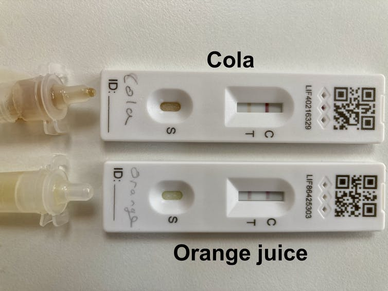 Image of positive tests, using cola and orange juice.
