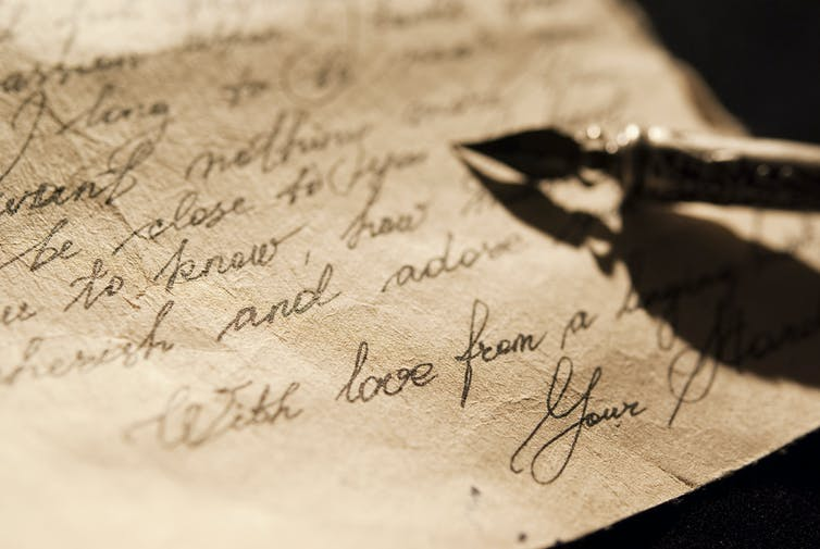 Antique quill on old written letter