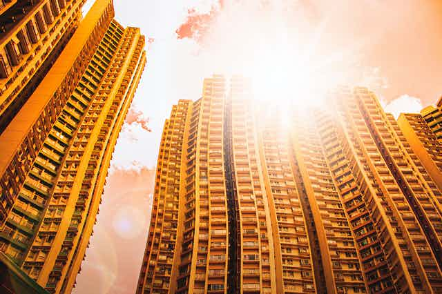 Tower blocks appearing wavy in the heat and direct sunlight.