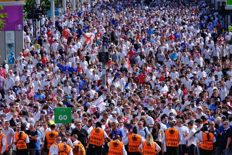 A sea of red and white as 20,500 England and Croatian football fans leave Wembley stadium after a group stage game