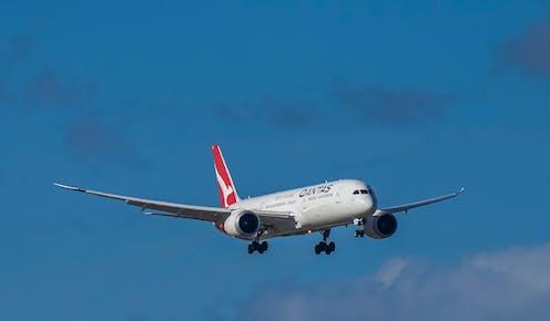 Qantas plane in sky.