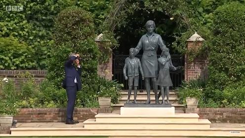 Sculptor Ian Rank-Broadley photographs his sculpture of Princess Diana