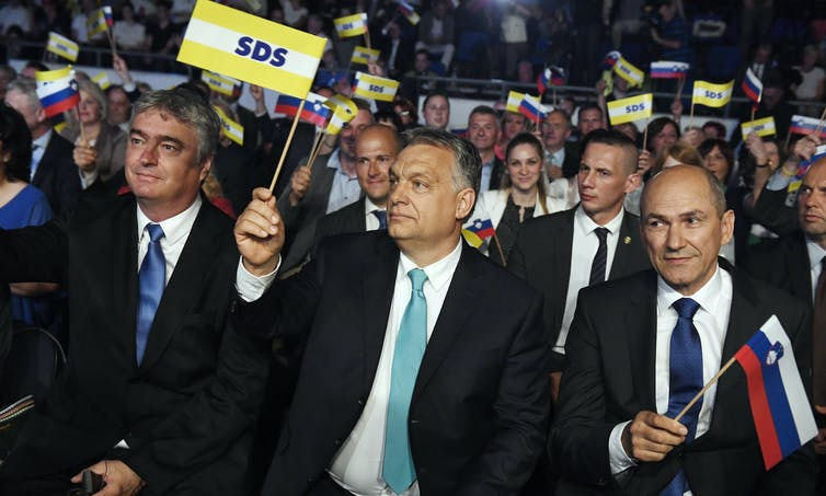 From left: European Parliament member of SDS Milan Zver, Viktor Orbán and Janez Janša pictured at a campaign event.