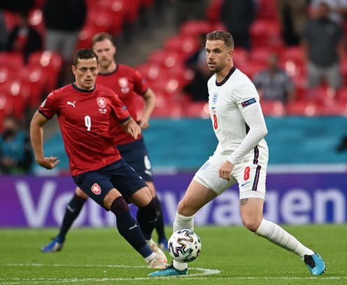 England footballer Jordan Henderson about to be tackled by Tomas Holes of the Czech Republic