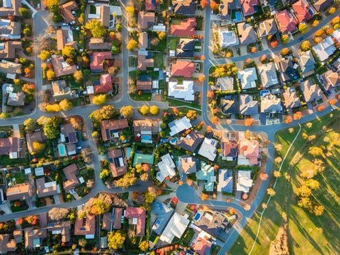 Aerial view of detached suburbian houses.