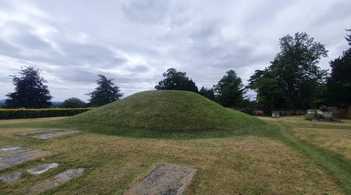 A burial mound surrounded by graves