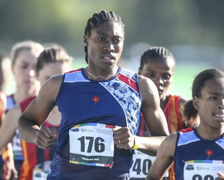 Waist-up shot of Semenya in the middle of a pack of other runners, mid-stride.