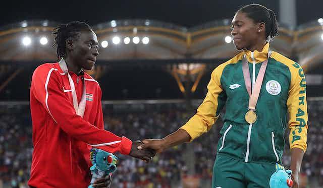 Wambui and Semenya shake hands on the podium.