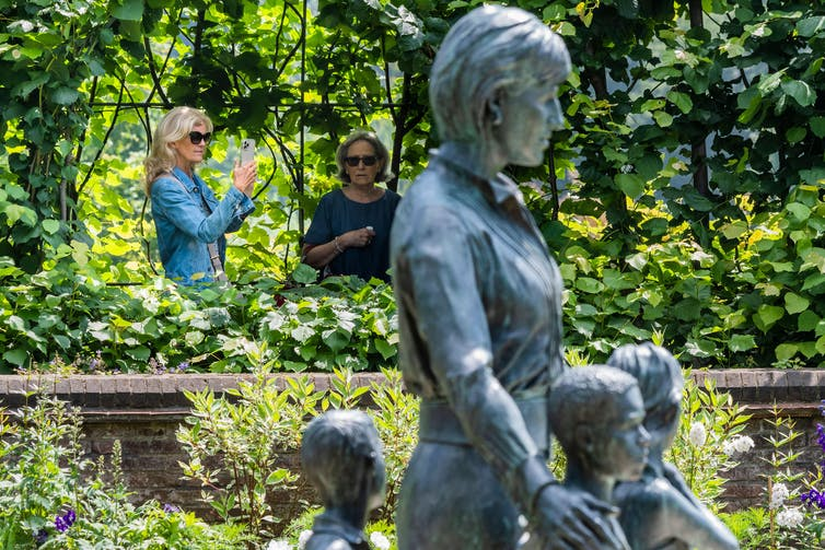 Statue of Diana, Princess of Wales with three unidentified children at Highgrove, the Spencer family seat.