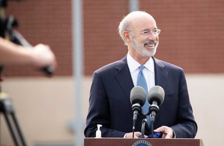 Pennsylvania Gov. Tom Wolf, standing behind a microphone at a podium.