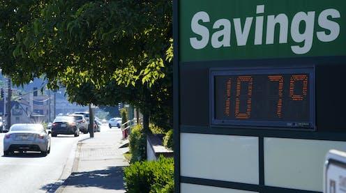 A bank sign displays a temperature of 107 F.