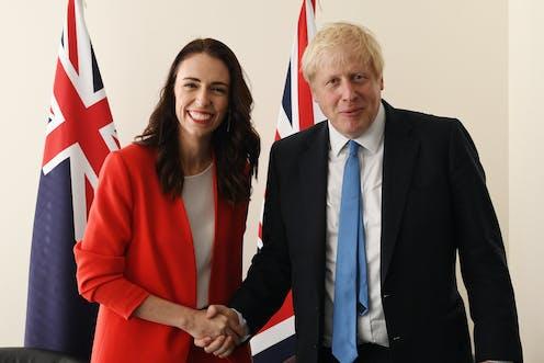 Jacinda Ardern shaking hands with Boris Johnson
