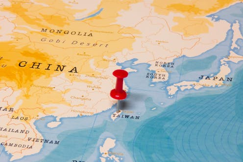 Map of China and Taiwan with red pin in Taiwan.