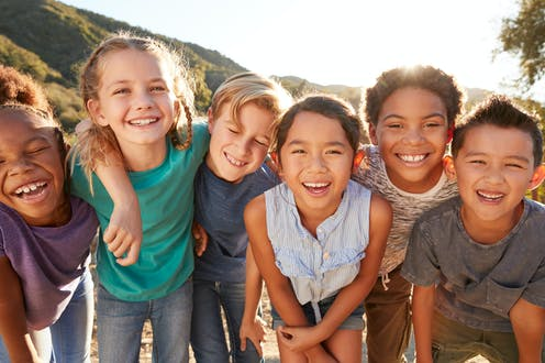 A group of smiling children.