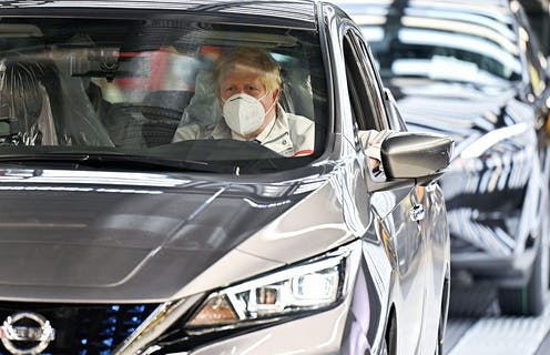 Boris Johnson in a new Nissan on the production line.