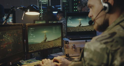 Soldier at computer controlling rocket launch.