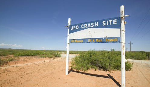 A sign in the desert saying 'UFO crash site.'