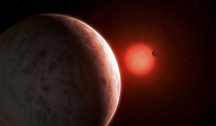 An exoplanet orbiting a red dwarf star.