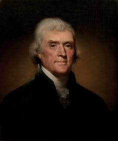A portrait of Thomas Jefferson in his later years, wearing a black jacket, white shirt and looking dignified, as befits a president.
