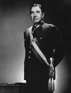 Portrait of Chilean dictator Augusto Pinochet wearing ceremonial uniform.
