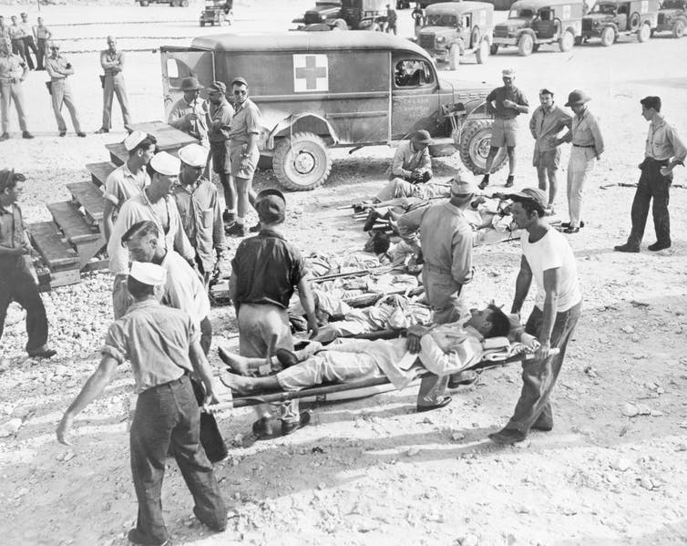 Survivors are carried on stretchers following their rescue.