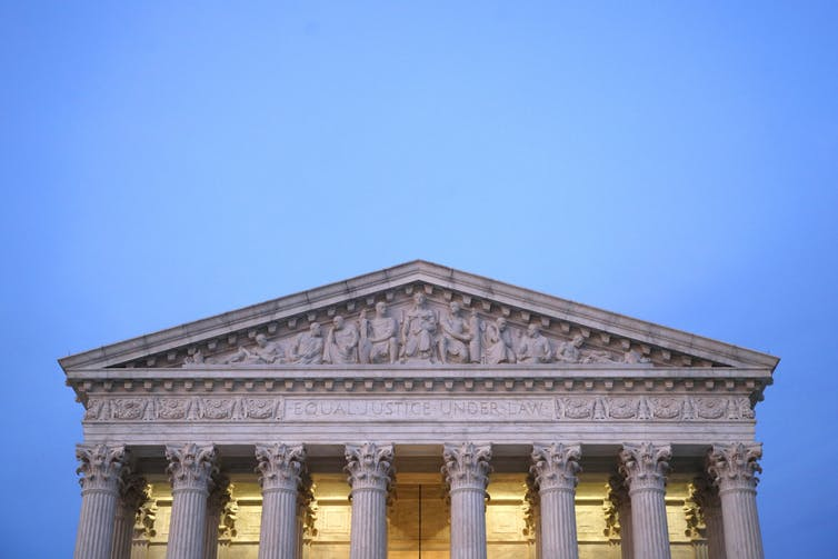 The top of the U.S. Supreme Court building.