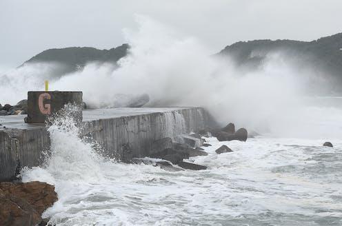 waves crashing on a breakwater
