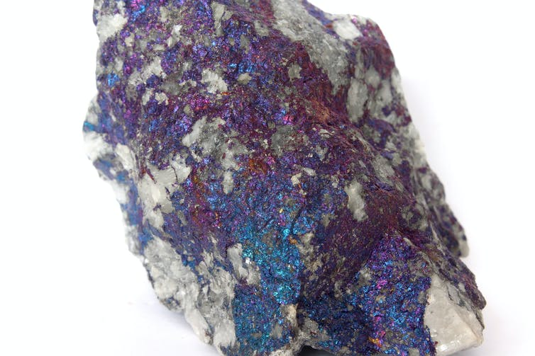 A sample of copper hosted in a quartz vein in the form of a mineral called chalcopyrite. When exposed to air, the surface oxidises to create this metallic 'peacock' lustre. Marek Novotňák / Wikimedia Commons