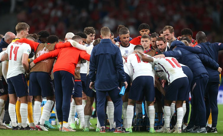Gareth Southgate speaks to his squad on the pitch after 90 minutes on the pitch against Denmark.
