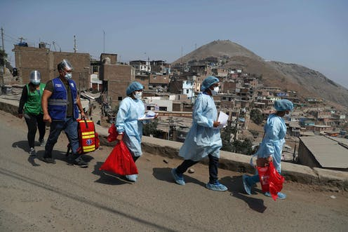 Medics in charge of vaccination in Lima, Peru