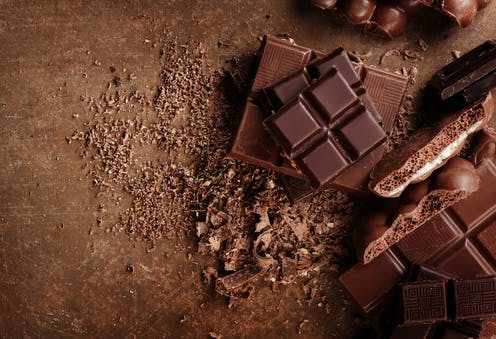 A selection of chocolate squares and shavings.