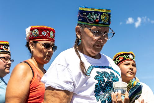 Indigenous women pray for water during an environmental protest