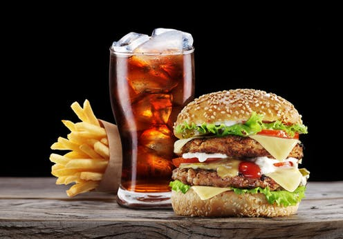 Burger, fries and a drink combo fast food meal