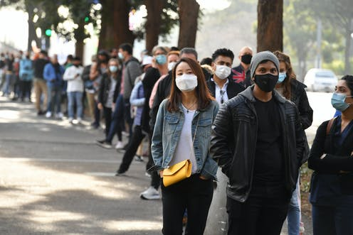 Sydneysiders line up for to get a COVID vaccination.
